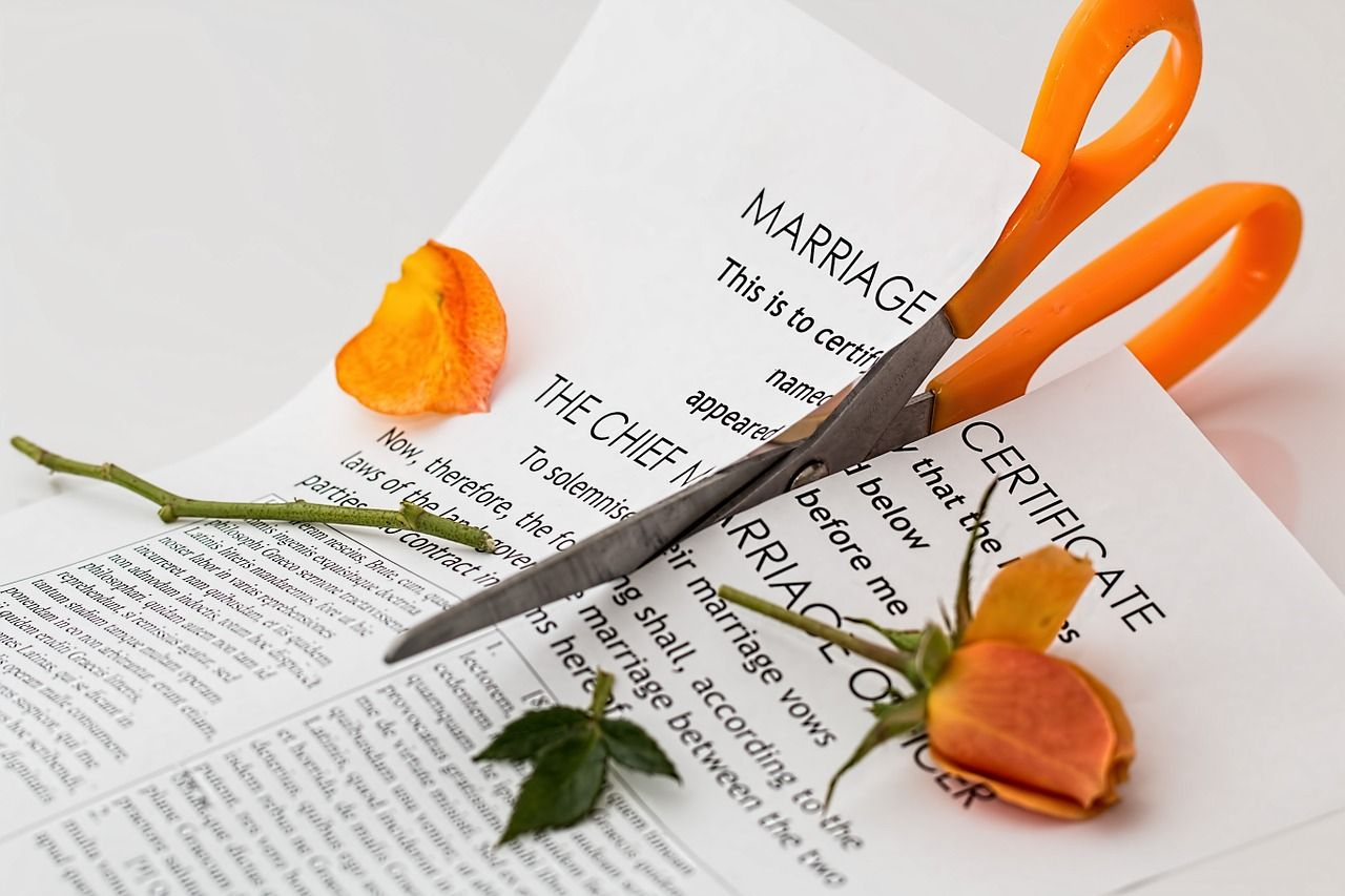 cutting marriage papers