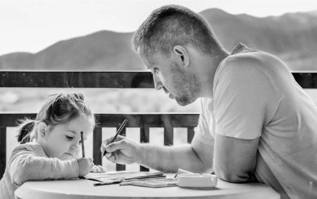 father and daughter drawing