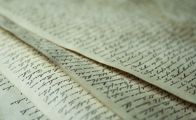 papers with cursive writing