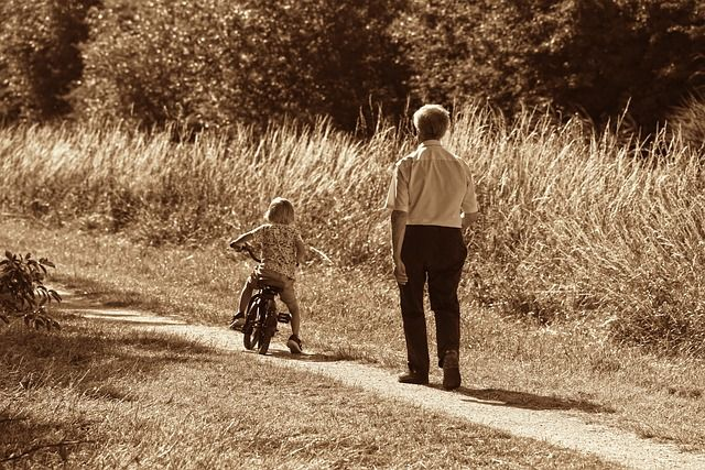 kid on bike with grandfather