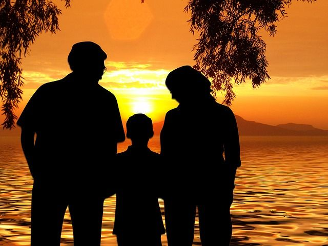 family outline at sunset