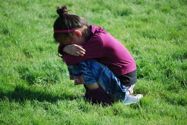 girl crying in field