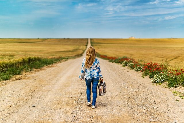 girl walking on road alone