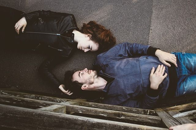 couple laying on floor